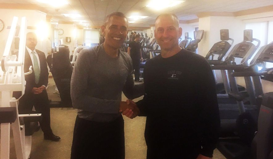 In this photo provided by the Boston Red Sox, President Barack Obama, left, shakes hands with Boston Red Sox Interim Manager Torey Lovullo in the exercise room of the New York Palace Hotel, Tuesday, Sept. 29, 2015, in New York. (Mike Hazen/Boston Red Sox via AP) MANDATORY CREDIT