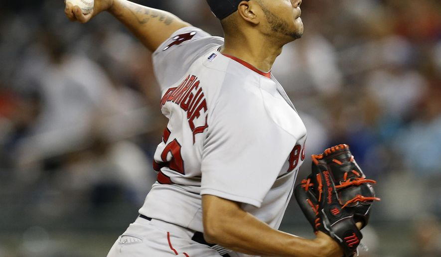 Boston Red Sox starting pitcher Eduardo Rodriguez delivers in the first inning of a baseball game against the New York Yankees at Yankee Stadium in New York, Monday, Sept. 28, 2015.  (AP Photo/Kathy Willens)