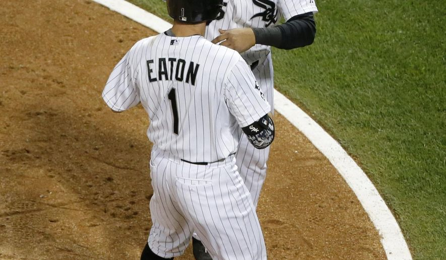 Chicago White Sox's Adam Eaton (1) and Carlos Sanchez celebrate Eaton's two-run home run off Kansas City Royals pitcher Johnny Cueto, during the fifth inning of a baseball game Tuesday, Sept. 29, 2015, in Chicago. (AP Photo/Charles Rex Arbogast)