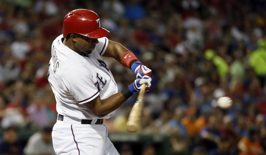 Texas Rangers' Elvis Andrus swings and connects for a sacrifice fly that scored Prince Fielder in the first inning of a baseball game Tuesday, Sept. 29, 2015, in Arlington, Texas. (AP Photo/Tony Gutierrez)