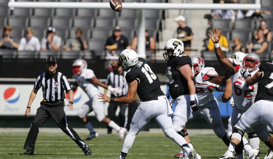 Colorado quarterback Sefo Liufau (13) throws during an NCAA college football game against Nicholls State, in Boulder, Colo., Saturday, Sept. 26, 2015. Colorado won 48 - 0. (AP Photo/Brennan Linsley)
