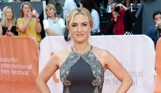 "In this Sept. 14, 2015, file photo, Kate Winslet attends the premiere for ""The Dressmaker"" at the Toronto International Film Festival at in Toronto. Winslet also stars with Michael Fassbender in ""Steve Jobs,"" a film about the Apple co-founder. (Photo by Evan Agostini/Invision/AP, File)"