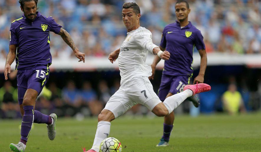 Real Madrid's Cristiano Ronaldo kicks the ball during a La Liga soccer match between Real Madrid and Malaga at the Santiago Bernabeu stadium in Madrid, Spain, Saturday, Sept. 26, 2015. (AP Photo/Daniel Ochoa de Olza)