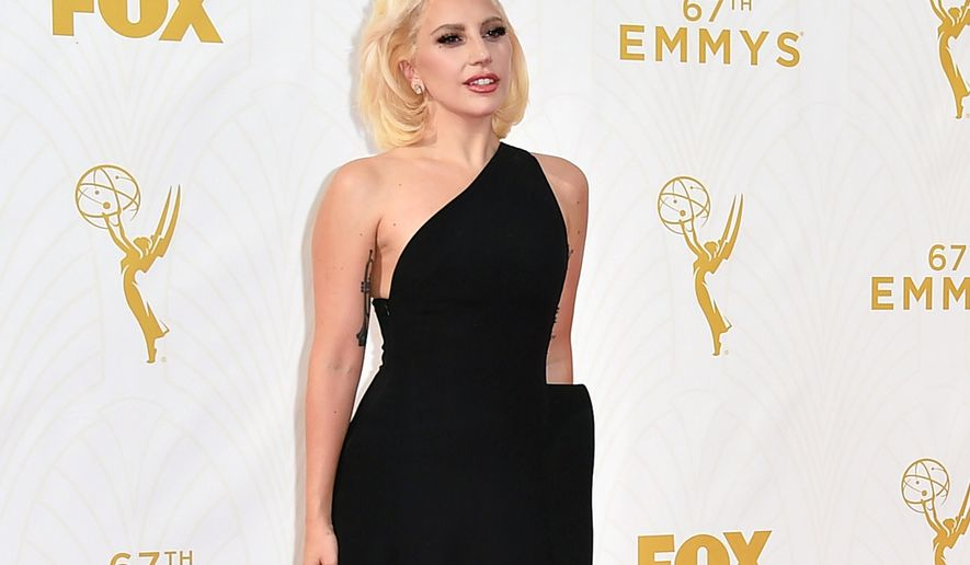 FILE - In this Sept. 20, 2015 file photo, Lady Gaga arrives at the 67th Primetime Emmy Awards in Los Angeles. Billboard announced Tuesday, Sept. 29, that the pop star will be honored at their annual Women in Music event on Dec. 11 in New York. The event, in its 10th year, will be televised on Lifetime. (Photo by Jordan Strauss/Invision/AP, File)