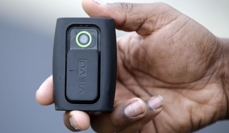 Whitestown Police Department officer Reggie Thomas holds a body camera that he wears while on his shift, Tuesday, Sept. 29, 2015 in Whitestown, Ind. An urban versus rural divide emerged during an Indiana legislative committee discussion of possible restrictions on the use of body cameras by police agencies. (AP Photo/Darron Cummings)