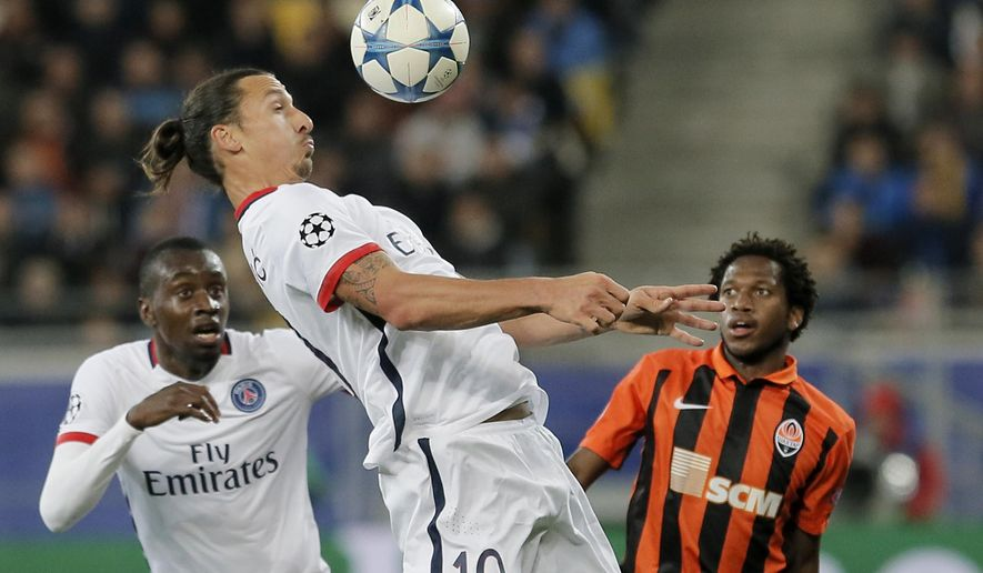 PSG's Zlatan Ibrahimovic, left, controls the ball as Shakhtar's Fred looks him during the Champions League group A soccer match between Shakhtar Donetsk and Paris Saint Germain at the Arena Lviv stadium in Lviv, Western Ukraine, Wednesday, Sept. 30, 2015. (AP Photo/Efrem Lukatsky)