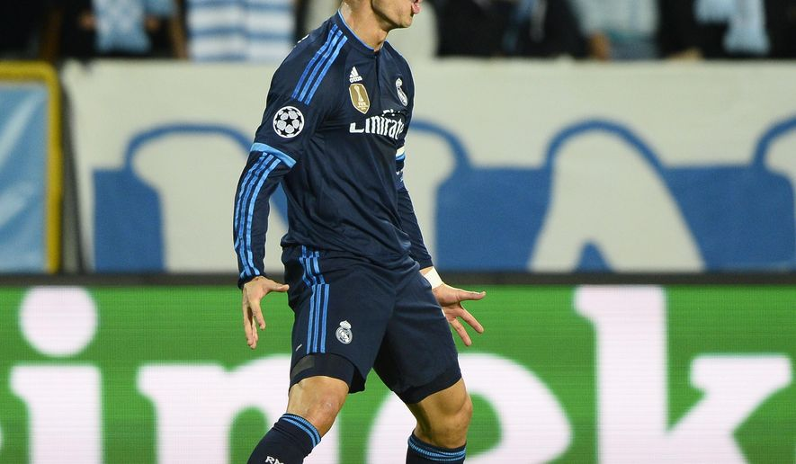 Real Madrids Cristiano Ronaldo celebrates after scoring the opening goal during the UEFA Champions League group A football match between Malmo FF and Real Madrid at Malmo New Stadium in Malmo, Sweden, Wednesday Sept. 30, 2015. (Anders Wiklund / TT via AP) SWEDEN OUT