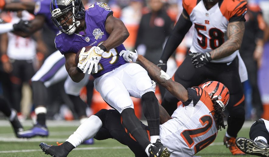 FILE - In this Sept. 27, 2015 file photo, Baltimore Ravens running back Justin Forsett (29) is stopped by Cincinnati Bengals cornerback Adam Jones (24) during the first half of an NFL football game in Baltimore. The Ravens don't have much time to lament their status as the only winless team in the AFC because a division matchup on the road at Pittsburgh looms Thursday, Oct. 1.   (AP Photo/Nick Wass)