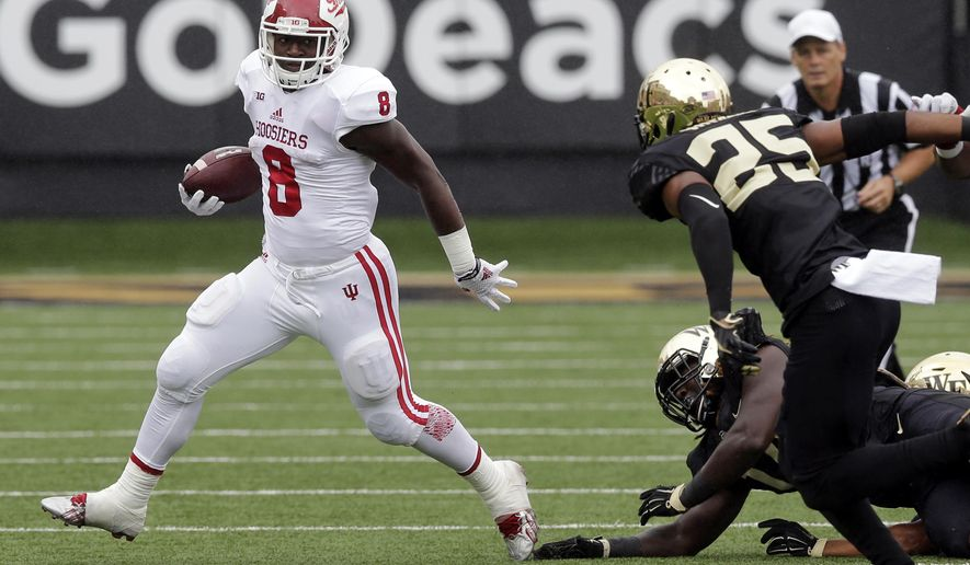 FILE - In this Sept. 26, 2015, file photo, Indiana's Jordan Howard (8) runs against Wake Forest during the first half of an NCAA college football game in Winston-Salem, N.C. This Saturday, Oct. 3, sets up as the biggest of the season so far in college football for former Blazers, including Howard. The undefeated Hoosiers take on No. 1 Ohio State in the biggest game to be played in Bloomington in decades, putting Howard on the big stage for the first time in his career. (AP Photo/Chuck Burton, File)