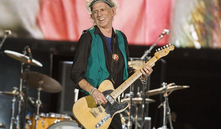 """FILE - In this July 15, 2015 file photo, Keith Richards of the Rolling Stones seen at the Le Festival d'ete de Quebec in Quebec City, Canada. Richards released an album, """"Crosseyed Heart,"""" on Sept. 18.  (Photo by Barry Brecheisen/Invision/AP, File)"""