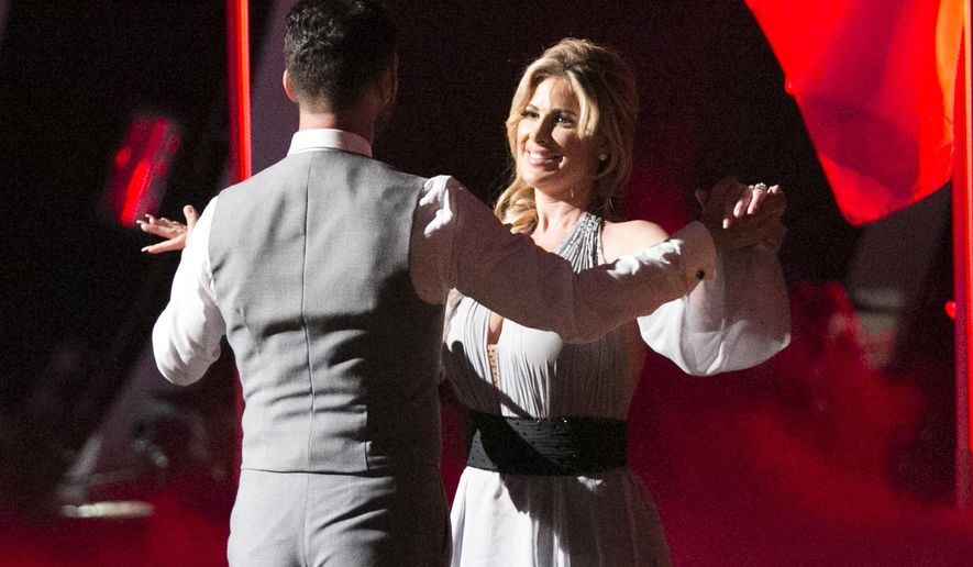 "In this Sept. 22, 2015 photo released by ABC, Tony Dovolani, left, and Kim Zolciak Biermann perform on the celebrity dance competition series, ""Dancing with the Stars,"" in Los Angeles.  Zolciak Biermann is the latest contestant who has injured themselves, either on, or while rehearsing for the show. She suffered a so-called ""mini-stroke""  flying home from Los Angeles. (Adam Taylor/ABC via AP)"