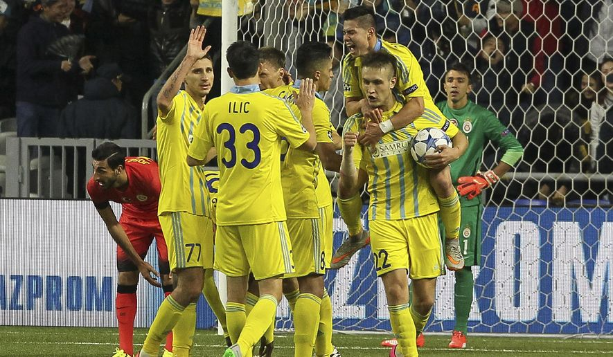 Astana players celebrate their goal against Astana during the Champions League group C soccer match between Astana and Galatasaray in Astana, Kazakhstan, Wednesday, Sept. 30, 2015. (AP Photo/Alexey Filippov)