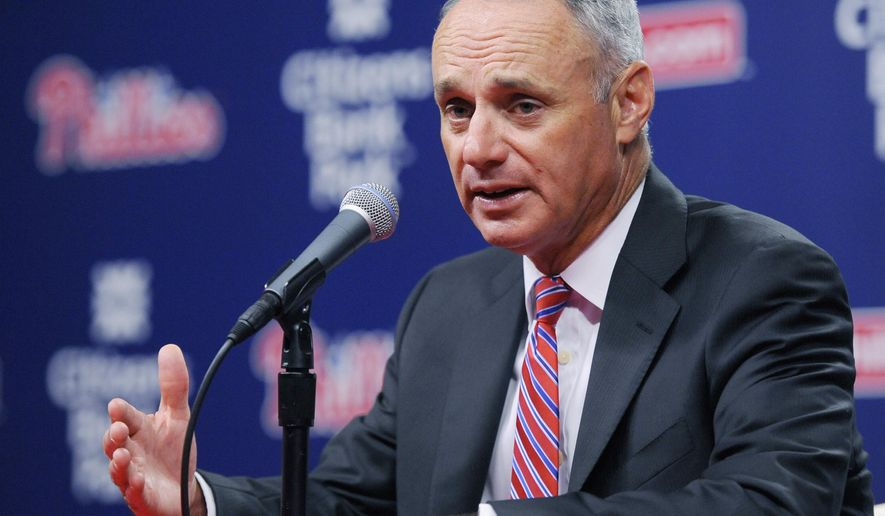 FILE - In this Aug. 27, 2015, file photo, Major League Baseball Commissioner Rob Manfred talks to members of the media during a news conference in Philadelphia. Manfred envisions more experiments with speed-up rules, such as limiting pitching changes and trips to the mound, or requiring each pitcher to face multiple batters. Speaking at the Sports Diversity & Inclusion Symposium on Wednesday, Sept. 30, 2015, the new baseball commissioner said he doesn't see any need to expand the designated hitter to the National League. (AP Photo/Michael Perez, File)