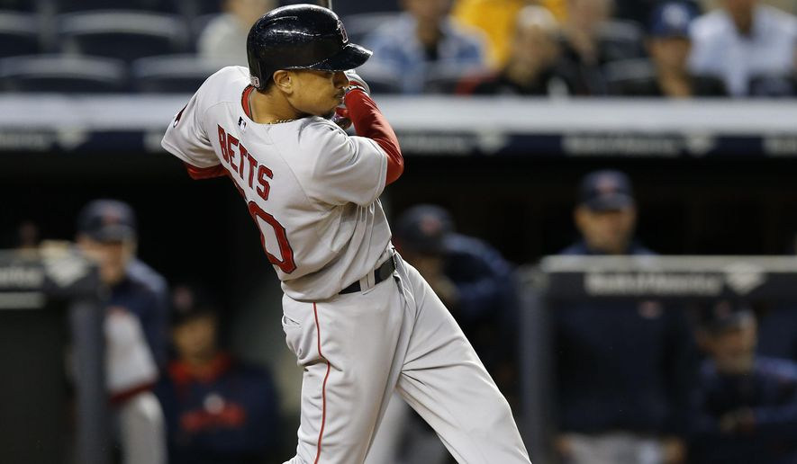 Boston Red Sox Mookie Betts hits an 11th inning, two-run home run in a baseball game against the New York Yankees in New York, Wednesday, Sept. 30, 2015.   (AP Photo/Kathy Willens)
