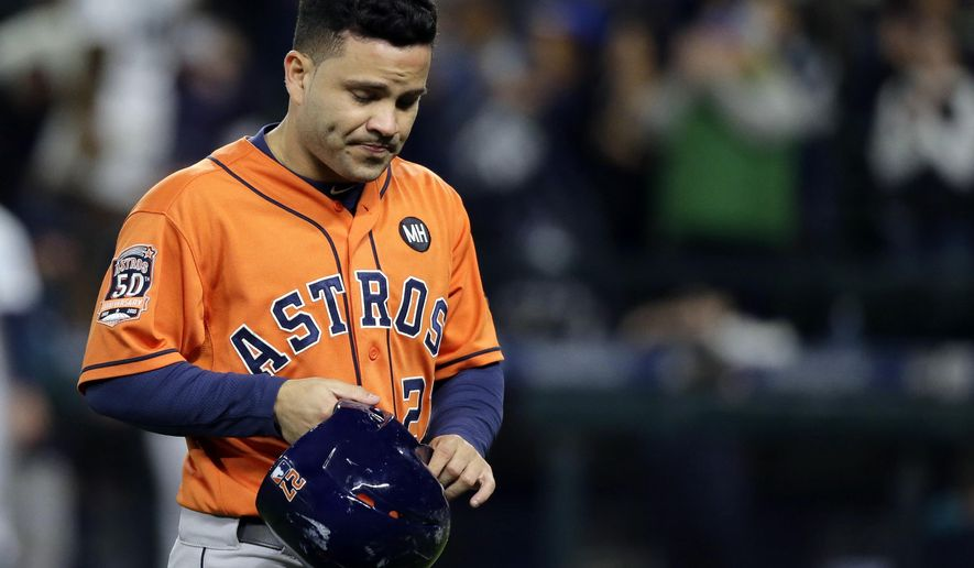 Houston Astros' Jose Altuve walks off the field after being stranded on second base at the end of the ninth inning of a baseball game against the Seattle Mariners, Tuesday, Sept. 29, 2015, in Seattle. The Mariners beat the Astros 6-4. (AP Photo/Ted S. Warren)