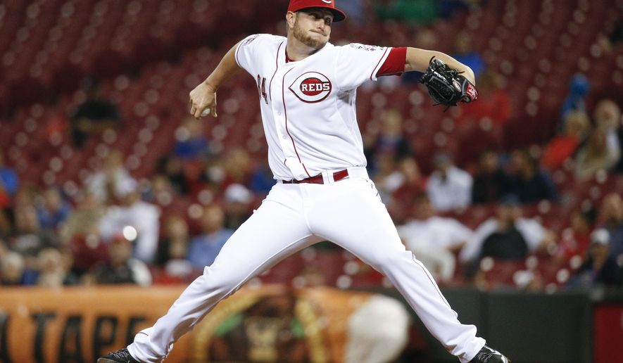 Cincinnati Reds starting pitcher Josh Smith throws during the second inning of a baseball game against the Chicago Cubs, Tuesday, Sept. 29, 2015, in Cincinnati. (AP Photo/John Minchillo)