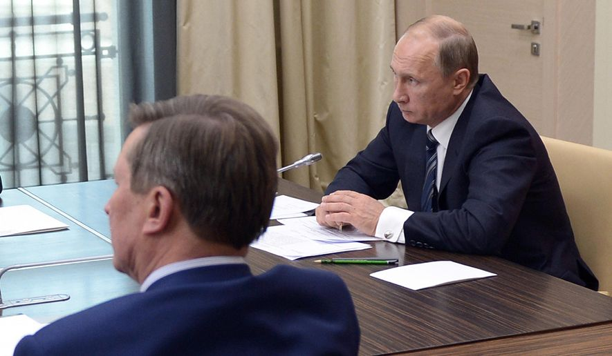 Russian President Vladimir Putin, right, holds a meeting with senior government officials at the Novo-Ogaryovo residence outside Moscow, Russia on Wednesday, Sept. 30, 2015. (Alexei Nikolsky/RIA Novosti, Kremlin Pool Photo via AP)