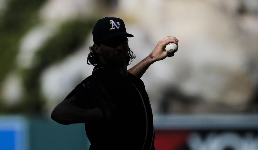 Oakland Athletics starting pitcher Barry Zito throws against the Los Angeles Angels during the first inning of a baseball game, Wednesday, Sept. 30, 2015, in Anaheim, Calif. (AP Photo/Jae C. Hong)
