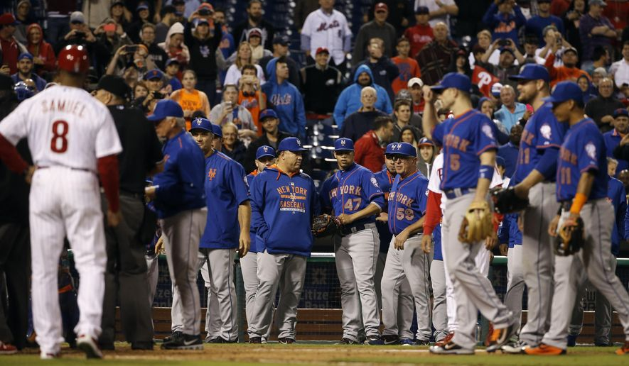 New York Mets relief pitcher Hansel Robles (47) looks back to the field after being ejected for nearly hitting Philadelphia Phillies' Cameron Rupp during the sixth inning of a baseball game, Wednesday, Sept. 30, 2015, in Philadelphia. (AP Photo/Matt Slocum)