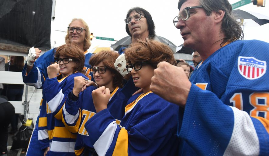 The Hanson Brothers, from left,  Dave Hanson, Steve Carlson and Jeff Carlson pose with the little Hanson Bros  from left, Jackson Rupert, Gavin Hockenberry and Parker Lavis at the morning hockey practice before the NHL pre-season hockey game between the Pittsburgh Penguins and Tampa Bay Lighting.  (Todd Berkey/The Tribune-Democrat via AP) MANDATORY CREDIT