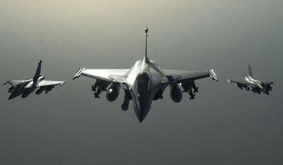 This photo released on Sunday, Sept. 27, 2015 by the French Army Communications Audiovisual office (ECPAD) shows French army Rafale fighter jets flying towards Syria as part of France's Operation Chammal launched in September 2015 in support of the US-led coalition against Islamic State group. Six French jet fighters targeted and destroyed an Islamic State training camp in eastern Syria in a five-hour operation on Sunday, President Francois Hollande announced, making good on a promise to go after the group that he has said is planning attacks against several countries, including France. (French Army/ECPAD via AP) THIS IMAGE MAY ONLY BE USED FOR 30 DAYS FROM TIME TRANSMISSION.