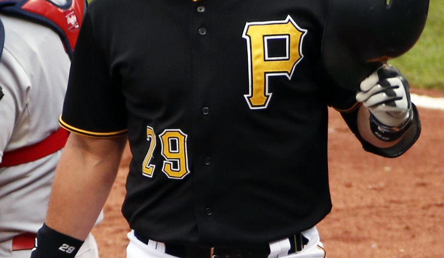 Pittsburgh Pirates' Francisco Cervelli celebrates as he returns to the dugout after hitting a grand slam off St. Louis Cardinals starting pitcher Michael Wacha in the fourth inning of a baseball game in Pittsburgh, Wednesday, Sept. 30, 2015. (AP Photo/Gene J. Puskar)