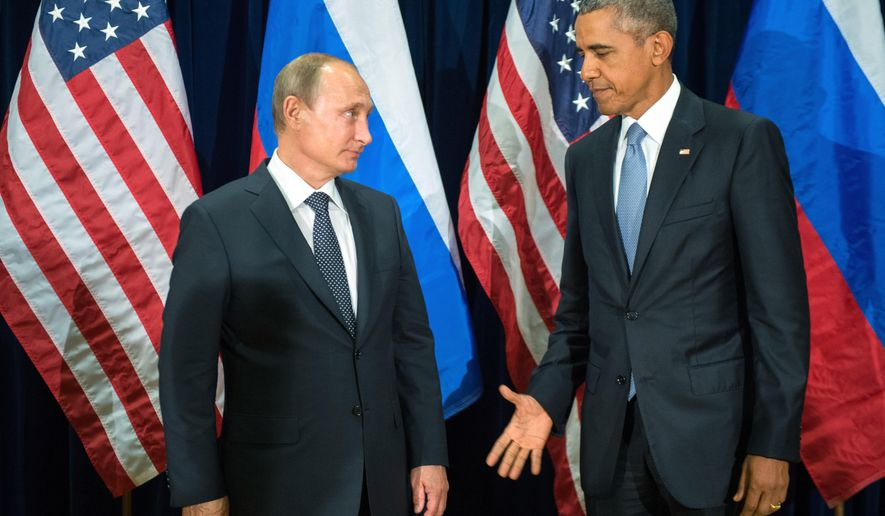U.S. President Barack Obama, right, and Russia's President Vladimir Putin pose for members of the media before a bilateral meeting Monday, Sept. 28, 2015, at United Nations headquarters. (Sergey Guneyev/RIA-Novosti, Kremlin Pool Photo via AP)