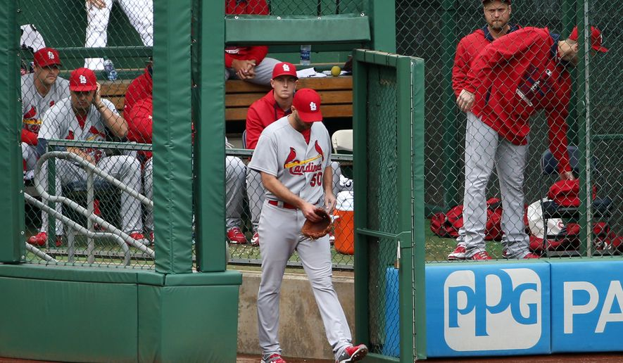 St. Louis Cardinals pitcher Adam Wainwright (50) walks from the bullpen to pitch the eighth inning of a baseball game against the Pittsburgh Pirates in Pittsburgh, Wednesday, Sept. 30, 2015. The Pirates won 8-2. (AP Photo/Gene J. Puskar)