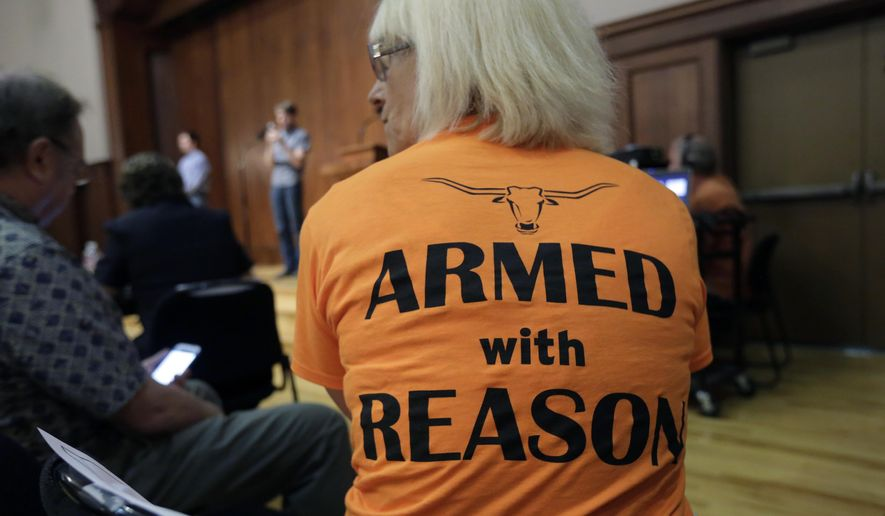 Professor Ann Cvetkovich waits to speak during a public forum as a special committee studies how to implement a new law allowing students with concealed weapons permits to carry firearms into class and other campus buildings, Wednesday, Sept. 30, 2015, in Austin, Texas. The law takes effect in August 2016. (AP Photo/Eric Gay)