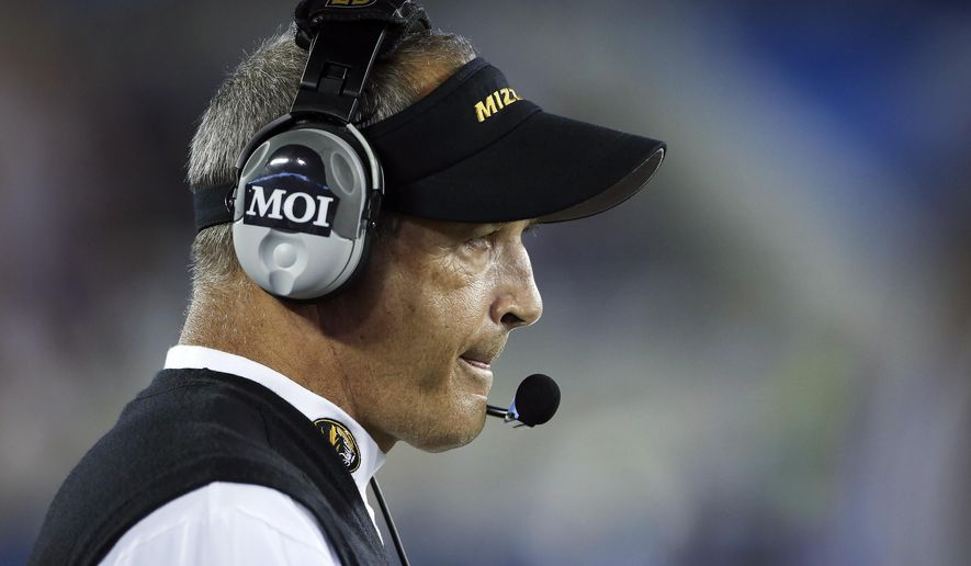 Missouri head coach Gary Pinkel watches his team during the second half of an NCAA college football game against Kentucky, Saturday, Sept. 26, 2015, in Lexington, Ky. Kentucky won the game 21-13. (AP Photo/David Stephenson)