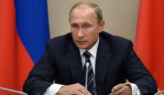 Russian President Vladimir Putin holds a meeting with senior government officials at the Novo-Ogaryovo residence outside Moscow, Russia on Wednesday, Sept. 30, 2015. Russian military jets carried out airstrikes against the Islamic State group in Syria on Wednesday for the first time, after President Vladimir Putin received parliamentary approval to send Russian troops to Syria. (Alexei Nikolsky/RIA Novosti, Kremlin Pool Photo via AP)