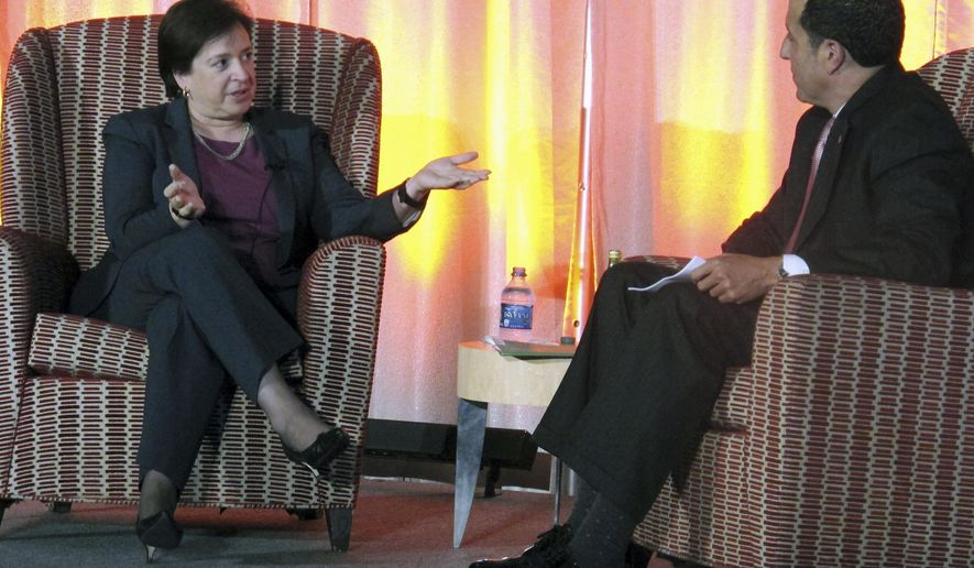 "Supreme Court Justice Elena Kagan talks about her work on the court after stints as Harvard Law School dean and U.S. Solicitor General, in a conversation with Ohio State University law school dean Alan Michaels, Wednesday, Sept. 30, 2015, in Columbus, Ohio. Kagan said she stands ""on the shoulders"" of former Justice Sandra Day O'Connor and fellow justice Ruth Bader Ginsburg. (AP Photo/Andrew Welsh-Huggins)"