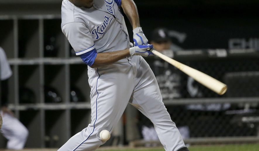 Kansas City Royals' Lorenzo Cain fouls a pitch from Chicago White Sox starting pitcher Jose Quintana into his right knee, during the seventh inning of a baseball game Wednesday, Sept. 30, 2015, in Chicago. (AP Photo/Charles Rex Arbogast)