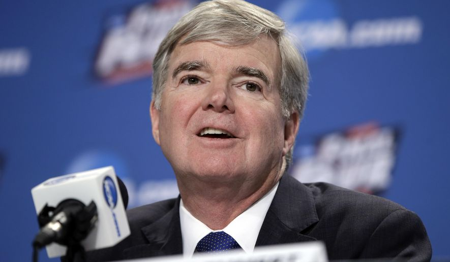 FILE - In this April 2, 2015, file photo, NCAA President Mark Emmert answers questions during a news conference at the Final Four college basketball tournament in Indianapolis. A federal appeals court agreed Wednesday, Sept. 30, 2015, that the NCAA's use of college athletes' names, images and likenesses in video games and TV broadcasts violated antitrust laws but struck down a plan to allow schools to pay players up to $5,000. (AP Photo/Darron Cummings, File)