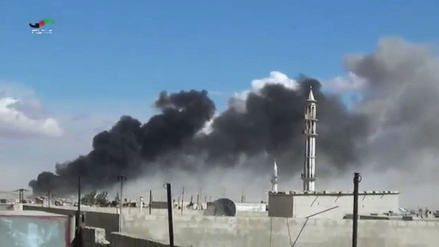 Smoke rises after airstrikes in western Syria in this image by Homs Media Centre, which has been verified by AP reporting. (Associated Press)