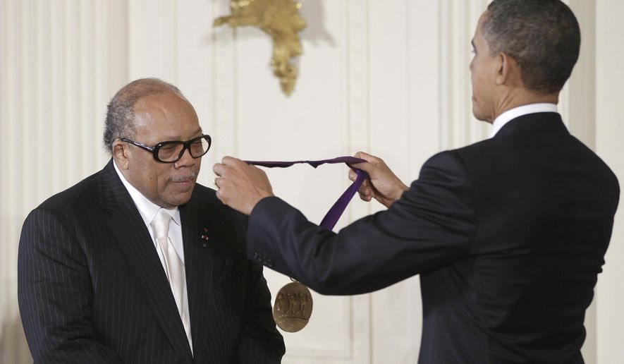 President Barack Obama presents a 2010 National Medal of Arts to musician and composer Quincy Jones, Wednesday, March 2, 2011, during a ceremony in the East Room of the White House in Washington. (AP Photo/Charles Dharapak)