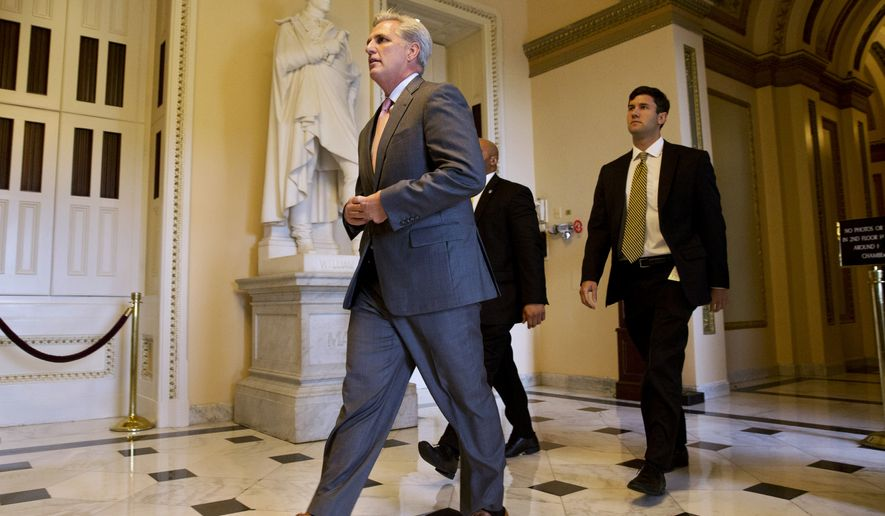 House Majority Leader Kevin McCarthy of Calif. leaves a procedural vote and debate in the House on a stopgap spending bill to avert a government shutdown on Sept. 30, 2015, on Capitol Hill in Washington. A temporary funding measure aiming to keep the government open past a midnight deadline sailed through the Senate on Wednesday and was expected to make its way shortly through a divided House and on to President Barack Obama. (Associated Press)
