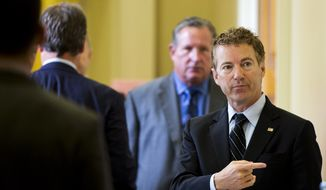 Sen. Rand Paul, Kentucky Republican and 2016 presidential candidate, points while talking with visitors on Capitol Hill in Washington on Sept. 30, 2015. (Associated Press)