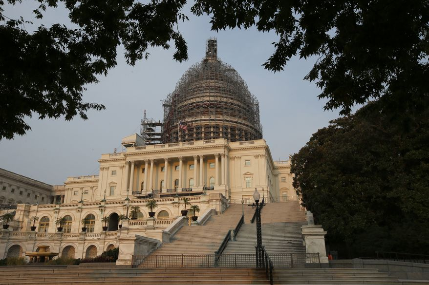 The west front of the U.S. Capitol is seen under repair Sept. 2, 2015 in Washington. (Associated Press) **FILE**