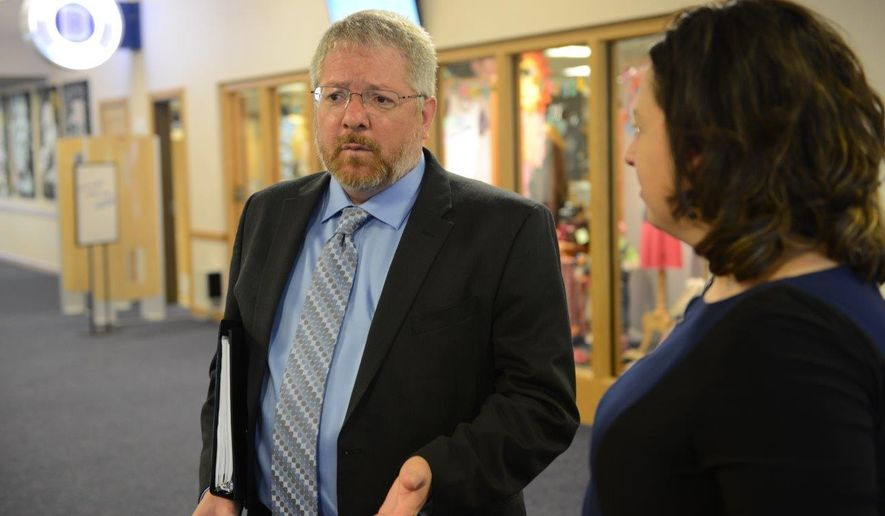 Thomas Mitzel talks with Dickinson State University administrator Marie Moe before a state Board of Higher Education meeting in Dickinson, N.D., on Wednesday, Sept. 30, 2015. Mitzel was named the new president at DSU Wednesday after he was interviewed by the board. He is a native of Aberdeen, S.D. (Billie Jo Lorius/ND Board Of Higher Education via AP))