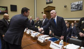 FILE - In this April 29, 2015, file photo, House Oversight and Government Reform Committee Chairman Rep. Jason Chaffetz, R-Utah, center, accompanied by the committee's ranking member Rep. Elijah Cummings, D-Md., left, greets Secret Service Director Joseph Clancy on Capitol Hill in Washington, before the start of the committee's hearing on how a small gyrocopter entered restricted airspace and landed on the West Lawn of the Capitol. A new government report concludes that scores of Secret Service employees improperly accessed the decade-old job application of Chaffetz, who was investigating scandals inside the agency. A deputy director was caught suggesting officials leak embarrassing information to retaliate against Chaffetz. The report said the actions could represent criminal violations under the U.S. Privacy Act. (AP Photo/Cliff Owen, File)