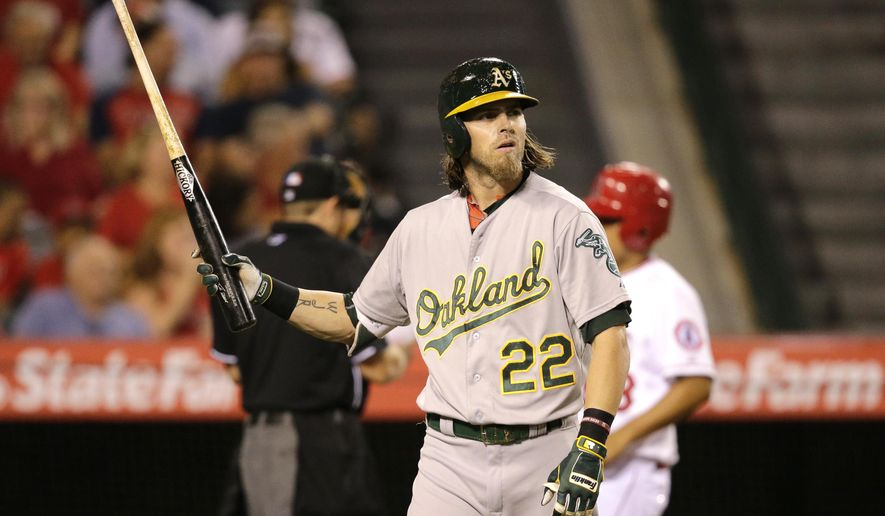 Oakland Athletics' Josh Reddick walks off the field after striking out during the fourth inning of a baseball game against the Los Angeles Angels, Tuesday, Sept. 29, 2015, in Anaheim, Calif. (AP Photo/Jae C. Hong)