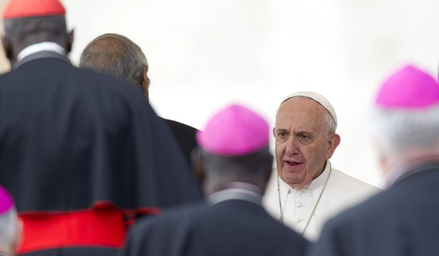 Pope Francis greets some prelates at the end of his weekly general audience in St. Peter's Square, at the Vatican, Wednesday, Sept. 30, 2015. (AP Photo/Riccardo De Luca)