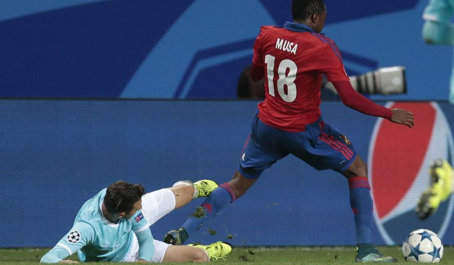 PSV's Santiago Arias, left, fouls CSKA's Ahmed Musa, resulting in a second yellow card and being sent off the pitch during a Champions League Group B soccer match between CSKA Moscow and PSV Eindhoven at the Arena Khimki stadium in Moscow, Russia, Wednesday Sept. 30, 2015. (AP Photo/Ivan Sekretarev)
