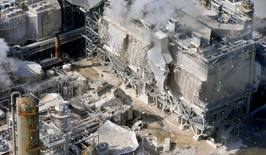 FILE - This Feb. 18, 2015 file photo shows a structure damaged after an explosion in a processing facility at the Exxon Mobil refinery in Torrance, Calif. PBF Energy Inc. announced Wednesday, Sept. 30, 2015 that Exxon Mobil is selling its troubled Southern California refinery for $537 million to a New Jersey energy company. Torrance plant is expected to close next year.The refinery has been shut down since an explosion in February injured four contractors and caused heavy damage. (Brad Graverson/Daily Breeze via AP, File)