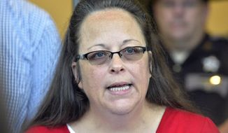In this Sept. 14, 2015, file photo, Rowan County Clerk Kim Davis makes a statement to the media at the front door of the Rowan County Judicial Center in Morehead, Ky. Davis, who refused to issue marriage licenses to same-sex couples, says she met briefly with the pope during his historic visit to the United States. (AP Photo/Timothy D. Easley, File)