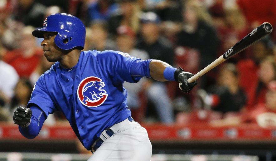 Chicago Cubs' Austin Jackson hits an RBI double off Cincinnati Reds starting pitcher Anthony DeSclafani in the fifth inning of a baseball game Wednesday, Sept. 30, 2015, in Cincinnati. (AP Photo/John Minchillo)