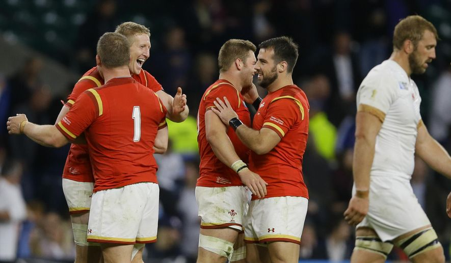 Wales players celebrate their 25-28 win after the Rugby World Cup Pool A match between England and Wales at Twickenham Stadium, London, Saturday, Sept. 26, 2015. (AP Photo/Kirsty Wigglesworth)