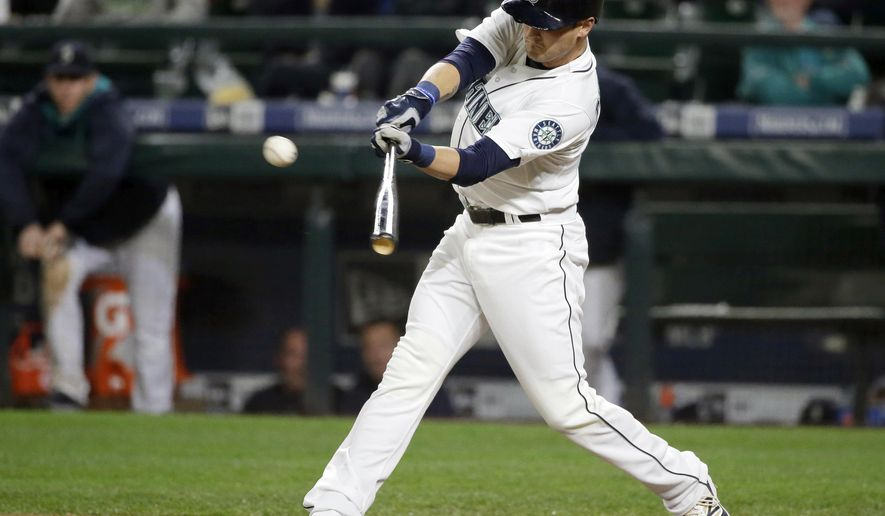 Seattle Mariners' Shawn O'Malley hits a go-ahead two-RBI single against the Houston Astros in the eighth inning of a baseball game Tuesday, Sept. 29, 2015, in Seattle. (AP Photo/Ted S. Warren)