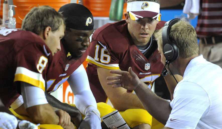In this photo taken Aug. 19, 2014, Washington Redskins offensive coordinator Sean McVay, right, talks on the sidelines with his three quarterbacks, from left, Kirk Cousin (8), Robert Griffin III and Colt McCoy (16) during the second half of an NFL preseason football game against the Cleveland Browns in Landover, Md. It's always something with the Washington Redskins quarterbacks: Starter Kirk Cousins has interception problems, No. 2 Colt McCoy is apparently hurt, and No. 3 Robert Griffin III , well, who knows where things stand with him? (AP Photo/Richard Lipski, File)
